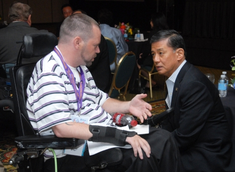 Secretary Eric Shinseki speaks with a Veterans at the 32nd National Veterans Wheelchair Games, which are taking places from June 25- June 30 in Richmond, Virginia. Photographer: Ken Holt. Photo Courtesy Dept. of Veterans Affairs.