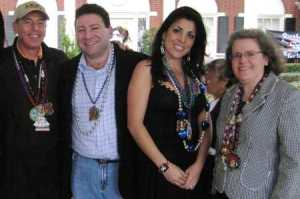 Credit Amy Scherzer / Tampa Bay Times. Gen. David Petraeus, left, Scott and Jill Kelley and Holly Petraeus watch the 2010 Gasparilla parade from the Kelleys' front lawn.