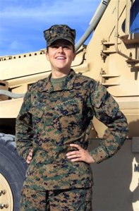 Lt. Brandy Soublet on the Marine base, 29 Palms in Southern California. Soublet is about as far from the war front as possible at her desk in the California desert, but she's on the front lines of an experiment that could one day put women as close to combat as their male peers. The Penfield, N.Y. woman is one of 45 female Marines assigned this summer to 19 all-male combat battalions. (AP Photo/USMC, Cpl. William J. Jackson)