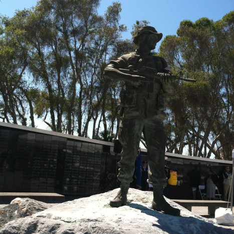 A bronze statue of a Special Forces member stands vigil over the names engraved on the black granite walls of the Special Operations Memorial at MacDill Air Force Base, Tampa, FL.