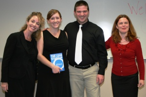 "Graduation night of the first Accelerated Entrepreneurs Certificate Program for Veterans at St. Petersburg College. Associate Professor Amy Sauers (L) presents an award for the top ""veteran's business pitch"" to Casey Crane and John Crane. Co-instructor Greta Kishbaugh (R)."