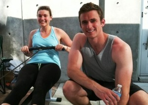 Shannon Casey (L) and Matt Casey (R) more than 7 hours into their rowing marathon on a sidewalk in downtown Tampa.