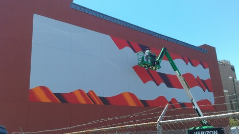 The American Flag mural being painted on the side of the Tampa Firefighters' Museum.