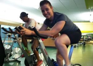Kiersten Downs at the USF student recreation center preparing for her cross-country journey.