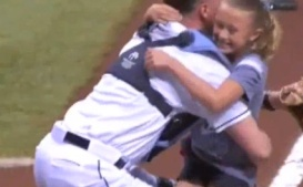 Alayna Adams leaps into the arms of her father, Lt. Col. Will Adams, after he surprised her at Thursday night's Rays game. Credit Screen Shot.