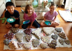 Children show off some of the heart rocks they painted for the National Veterans Wheelchair Games.
