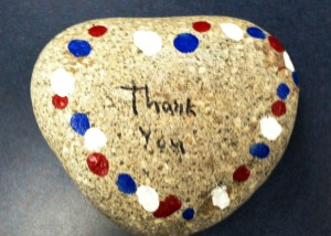 A close up of one of the veterans' heart rocks.
