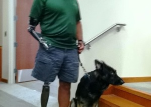 Cicero lost his right leg and arm to an IED explosion in Afghanistan. His service dog helps with his balance.