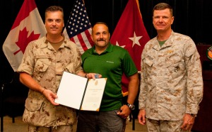 Canadian Forces Col. Paul Keddy (left) presents a commendation to Rick Cicero (middle) for helping to save the life of a Canadian soldier. Marine Major Gen. Dave Beydler of CENTCOM also participated in the ceremony.