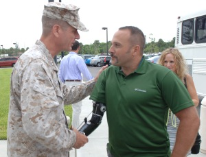 Marine Major Gen. Dave Beydler of U.S. Central Command shakes hands with Rick Cicero who was being recognized for helping to save the life of a Canadian soldier in Afghanistan in 2010.