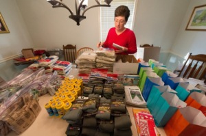 Dorie Griggs inventorying the supplies before packing them for shipping. PHOTO CREDIT: Stanley Leary