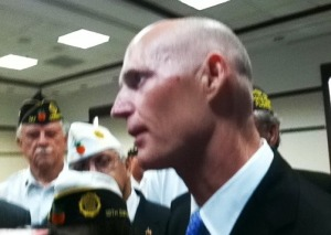 Gov. Rick Scott after signing a law that adds substantial civil penalties for defrauding or scamming a veteran or active duty military.
