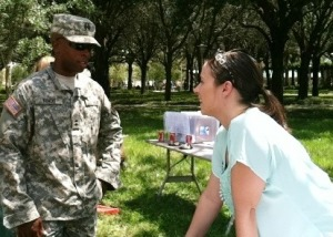 USF Army ROTC Battalion Commander Victor Benoit talks with Army veteran Rachael Meyer who was staffing the SVA table at the barbecue event.