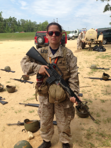 "Jacqueline Parker holds a ""dummy"" M16 while at the Marine summer leadership camp 2013."