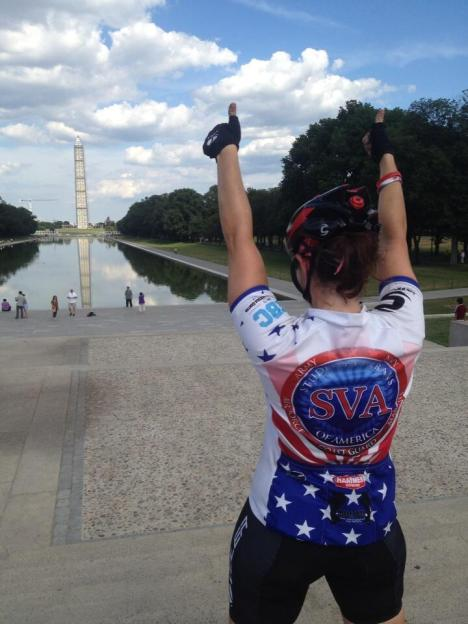 Kiersten Downs celebrating the end of her two-month ride across the USA to raise awareness for student veterans. Photo credit: Biking USA
