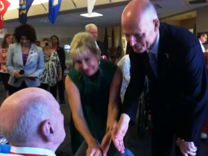 Florida First Lady Ann Scott and Gov. Rick Scott presented service medals to the veterans living and working at the state veterans nursing home in Land O'Lakes.