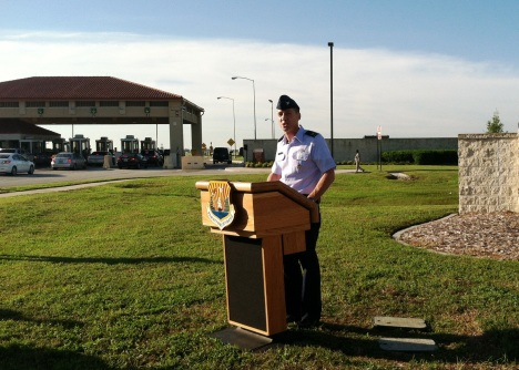 MacDill Air Force Base Commander Col. Scott DeThomas briefs reporters on the shutdown impact to civilian workers and military families outside the main gate.