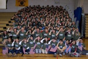 The Hastings Bears salute visiting veterans. Photo courtesy of History.com