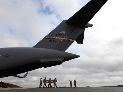 Jose Luis Magana / AP The coffin of Marine Lance Corporal Jeremiah M. Collins Jr. is brought home from Afghanistan.