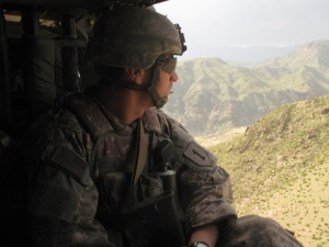 Army Capt. William Swenson looks out at the rough terrain of Eastern Afghanistan from a Black Hawk helicopter. Swenson will receive the Medal of Honor Tuesday for his actions in Afghanistan in 2009. Photo provided by the Army.