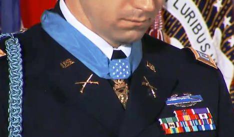 A close-up of the Medal of Honor after it was awarded to former Capt. Swenson - note the trail of a tear down his right cheek. Photo courtesy of the PBS News Hour web stream broadcast.