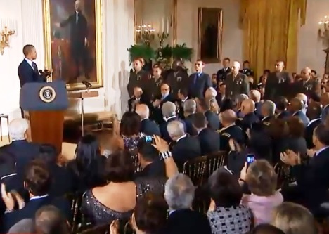 During the ceremony, President Obama asked the team of Army soldiers and Marines who took part in the battle to stand - acknowledging their contributions to the fight.