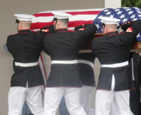 US Marines carry the casket of Congressman Bill Young into his memorial service.