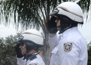 Pinellas County Sheriff's deputies salute the arrival of Congressman Young's casket.