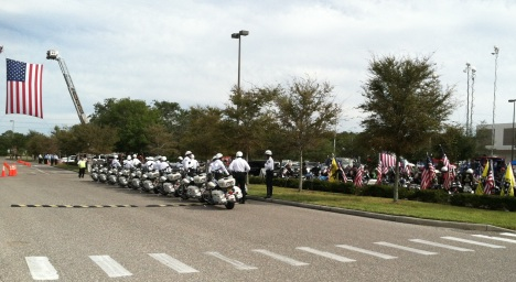Dozens of motorcycle deputies and Patriot Riders await Congressman Bill Young's escort to Bay Pines National Cemetery.