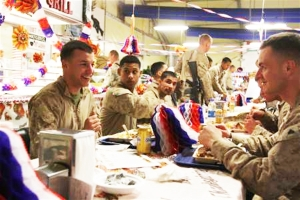 Marines with 3rd Battalion, 9th Marine Regiment, Regimental Combat Team 7 enjoy a Thanksgiving Day meal featuring turkey, mashed potatoes and gravy, stuffing and pumpkin pie in the dining facility at Forward Operating Base Geronimo, Afghanistan, Nov. 22, 2012. Credit Cpl. Timothy Lenzo / U.S. Marine Corps photo.