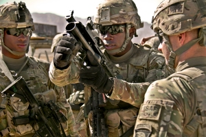 U.S. Army Pfc. Rohan Wright, center, a cavalry scout with a personal security detachment with the 4th Brigade Combat Team, 101st Airborne Division, prepares to fire an M203 grenade launcher at the weapons range at Forward Operating Base Thunder in Paktia province, Afghanistan, Oct. 18, 2013. U.S. Army photo by Sgt. Justin A. Moeller