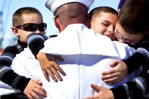 SAN DIEGO (Oct. 29, 2013) Engineman 1st Class Kevin Ives, assigned to the guided-missile cruiser USS Princeton (CG 59), embraces his sons during a homecoming celebration at Naval Base San Diego. Princeton conducted maritime security operations, theater security cooperation efforts and support missions for Operation Enduring Freedom. (U.S. Navy photo by Mass Communication Specialist 3rd Class Christopher Farrington