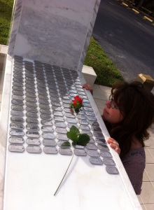 "The monument is being covered replicated ""dog tags"" with the names of Iraq War veterans."