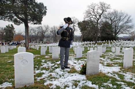 Sgt. Steven Thibodeau, police officer from the town of Scarborough, Maine, renders honors after placing a wreath at the grave marker during Wreaths Across America at Arlington National Cemetery in Arlington, Va., Dec. 14, 2013. DOD photo by Sebastian Sciotti Jr.