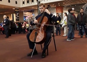 The cellist kicks off the concert by the U.S. Air Force Band Holiday Flash Mob at the National Air and Space Museum.