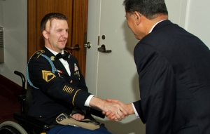 Sgt. 1st Class Cory Remsburg (left) shakes hands with Secretary Eric Shinseki before the State of the Union address. Photo courtesy of the Dept. of Veterans Affairs.