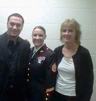 Marine Corps Staff Sergeant Kelly Matisi (center) with her brother and mother.