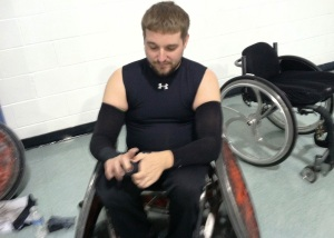 "Navy veteran Ryan ""Bully"" Lindstrom tapes up his hands and arms all the way to the elbows to help prevent injury during his rugby game."