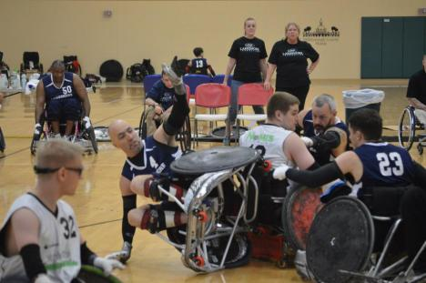 An opposing team player is upended during a Tampa Generals game at the 2013 Coloplast International Wheelchair Rugby Tournament.