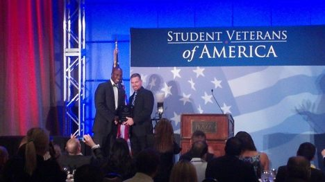 USF SVA President Ray Mollison (right) accepting the Student Veteran of the Year award for Kiersten Downs.
