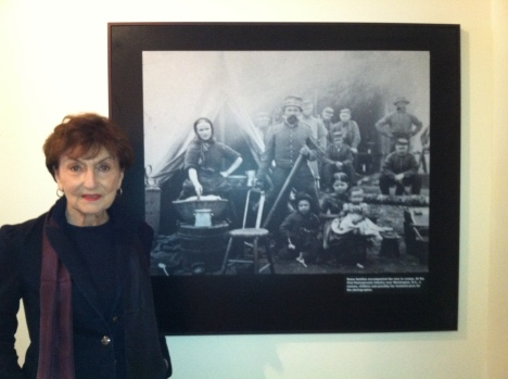 Curator Cyma Rubin stands next to a Civil War photograph of a family that captivated a school boy whose father was serving in Iraq.