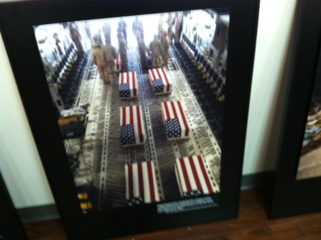 Curator Cyma Rubin chose rarely seen photos for the exhibit, with a few only a few iconic exceptions such as this photo of flag-draped coffins that the White House did not want released to the public.