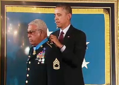 President Obama fastens the Medal of Honor around the neck of Staff Sgt. Melvin Morris in a ceremony Tuesday.