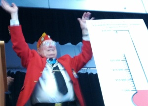 Hershel Williams cheers on students at the Franklin Boys Preparatory Academy as they applauded his $5,000 donation toward their effort to build a Gold Star Family Memorial.