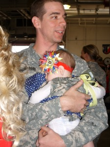 Brian Dorr holding his daughter Anastin who was an infant when he deployed. March 2011