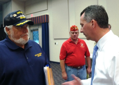 Navy veteran Robert Barrie talks with Cong. David Jolly about getting the USS NOA on the VA list for Agent Orange exposure.