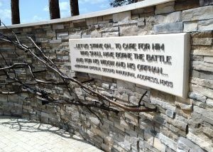 President Lincoln's famous quote about veterans and a bronze depiction of an empty nest by artist Ann Hirsch adorn the east entrance to Patriot Plaza.