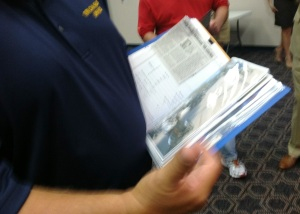 Robert Barrie holds a notebook stuffed with documentation he said shows the USS NOA served in coastal regions of Vietnam and was exposed to Agent Orange.