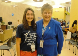 Youth volunteer Mairyn Harris, 14, and Kathleen Fogarty, director of James A. Haley VA Medical Center. (July 2014)