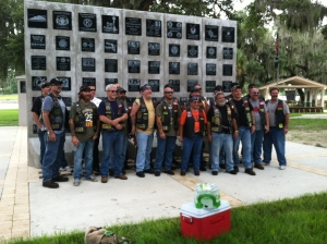 The Nam Knights Westside Motorcycle Club pose before the Iraq Veterans Memorial at Hillsborough County Veterans Memorial Park.